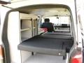 Travel-camper-location-T6-interieur-lit