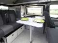 Travel-camper-location-T6-confort-interieur-table